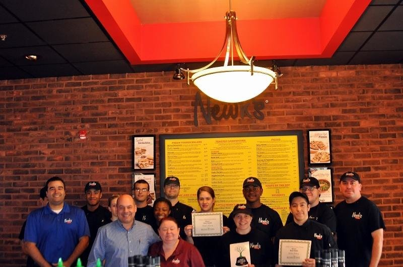 The staff members of Newk's Eatery in the Waugh Chapel Towne Centre were proud to receive their certificates for Best Lunch and Best Salad.