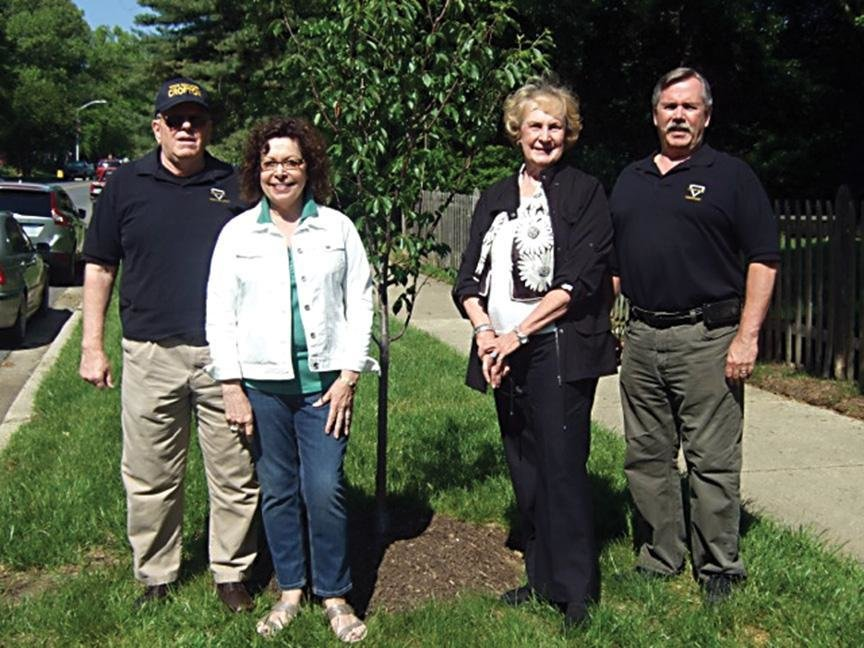 Larry Schweinsburg, Marcia Richard, Jane McClanahan and Steve Grimaud recently attended the planting ceremony to beautify Crofton Parkway with cherry trees as part of a project by the Crofton Village Garden Club.