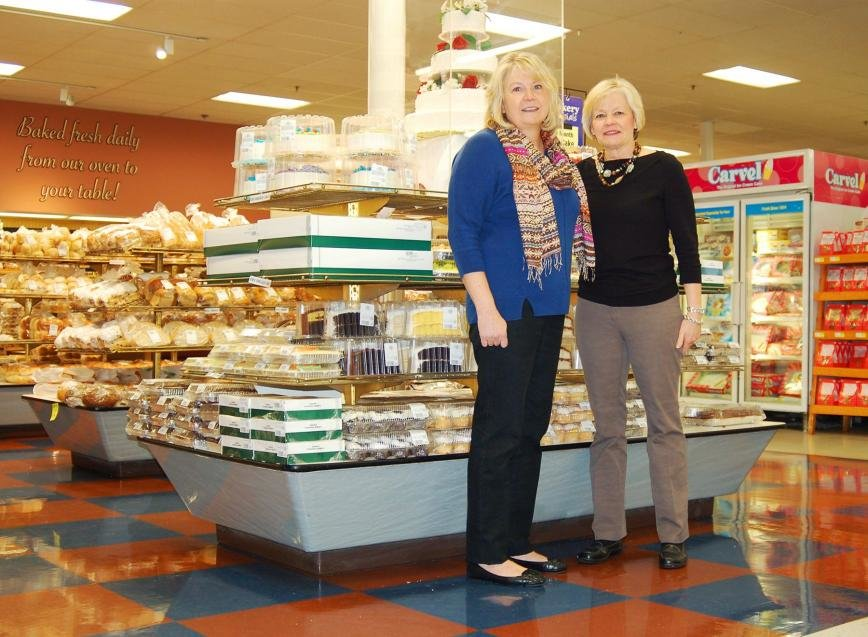 Sisters (l-r) Bernie Snoops and Babbie Poyer have managed Pasadena's two Lauer's Supermarket & Bakeries since they took over the business from parents Ed and Helen Lauer.