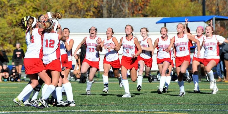 The Archbishop Spalding field hockey team rushed the field in celebration after Erin Shanahan's overtime penalty stroke lifted the Cavaliers to a 2-1 win over McDonogh in the Interscholastic Athletic Association of Maryland A Conference final at Goucher College on November 3. It is the program's first IAAM A Conference championship.