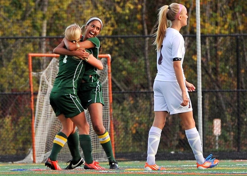 Clarissa Kirsch-Downs was embraced by Becky Frost after Frost's pass allowed Kirsch-Downs to score the game's only goal in the ninth minute.