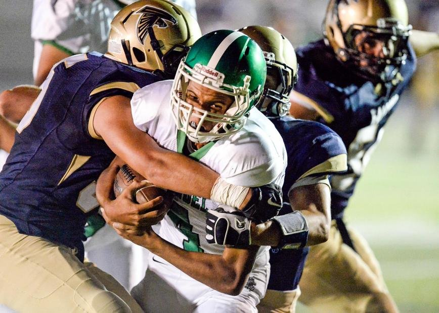 In his first game on the varsity squad, Arundel quarterback Anthony Messenger used his arm and his legs to overcome some early jitters and powre the Wildcats to their season-opening win over Severna Park on September 6.