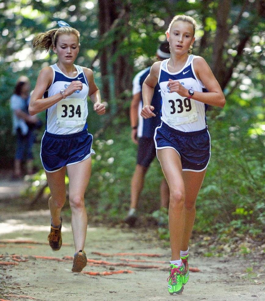Reilly Wagner (right) was the top finisher for the South River girls, taking second overall in leading the Seahawks to a fifth-place team finish, while teammate Carly Bunting (left) made it two Seahawks in the top four by taking fourth overall.