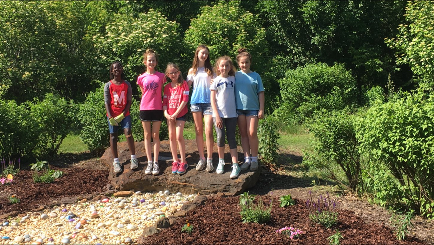A local Girl Scout Troop decided to spread some kindness by making a rock garden and painting the stones with encouraging messages.