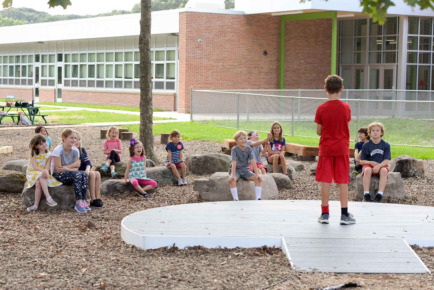 With the new nature space, kids can perform in front of a small audience, walk along a balance beam, investigate nature or read a book outside.