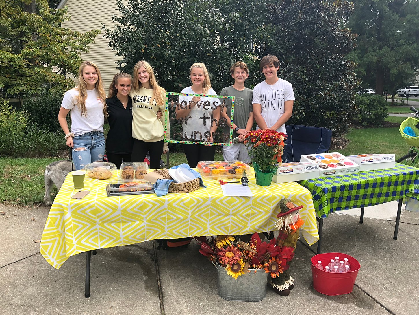 Jacqueline Cloud (center) helped English teacher Leala Smith raise $230 for Harvest for the Hungry by selling baked goods.