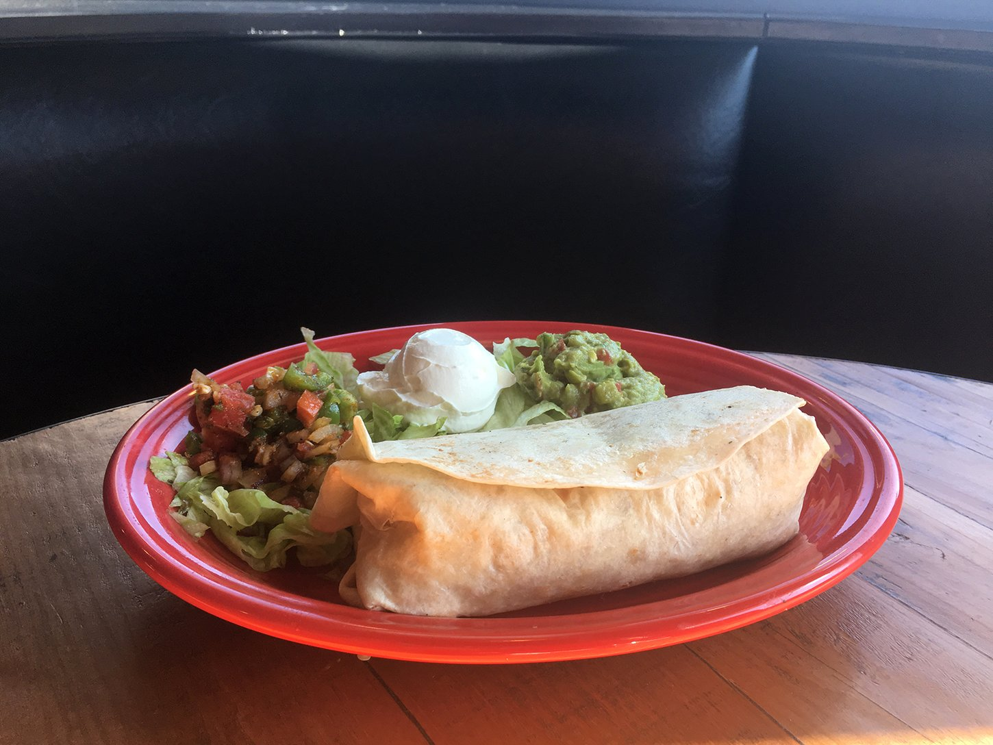 The steak in the burrito was seared to perfection and stuffed into a large, soft burrito along with fresh lettuce, tomatoes, cheese, sour cream and ultra-fresh guacamole.
