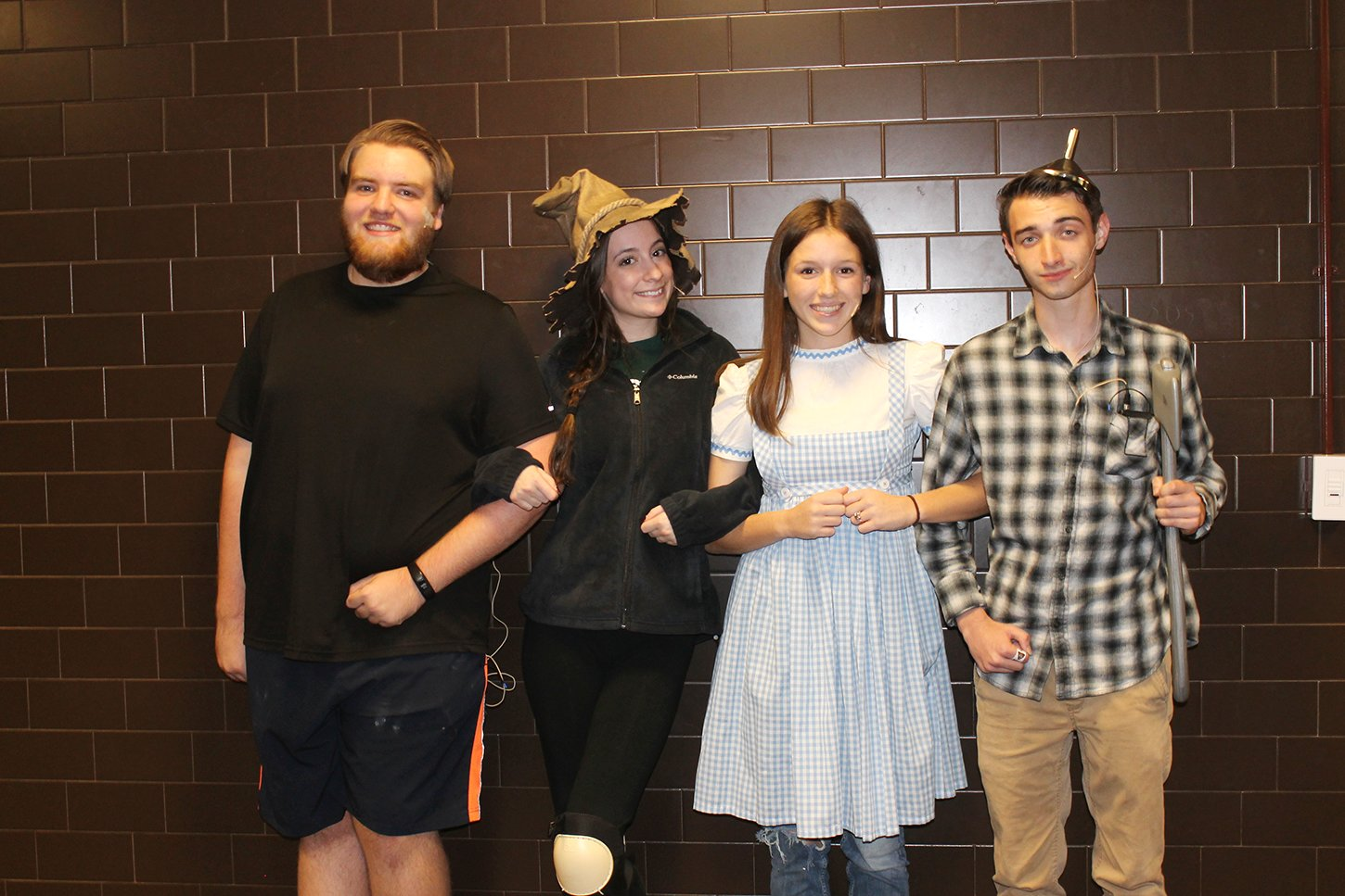 """The Wizard of Oz"" cast includes (l-r) Andrew Solley as the Cowardly Lion, Bethany Wright as the Scarecrow, Lillie Jewell as Dorothy and Zach Demers as the Tin Man."