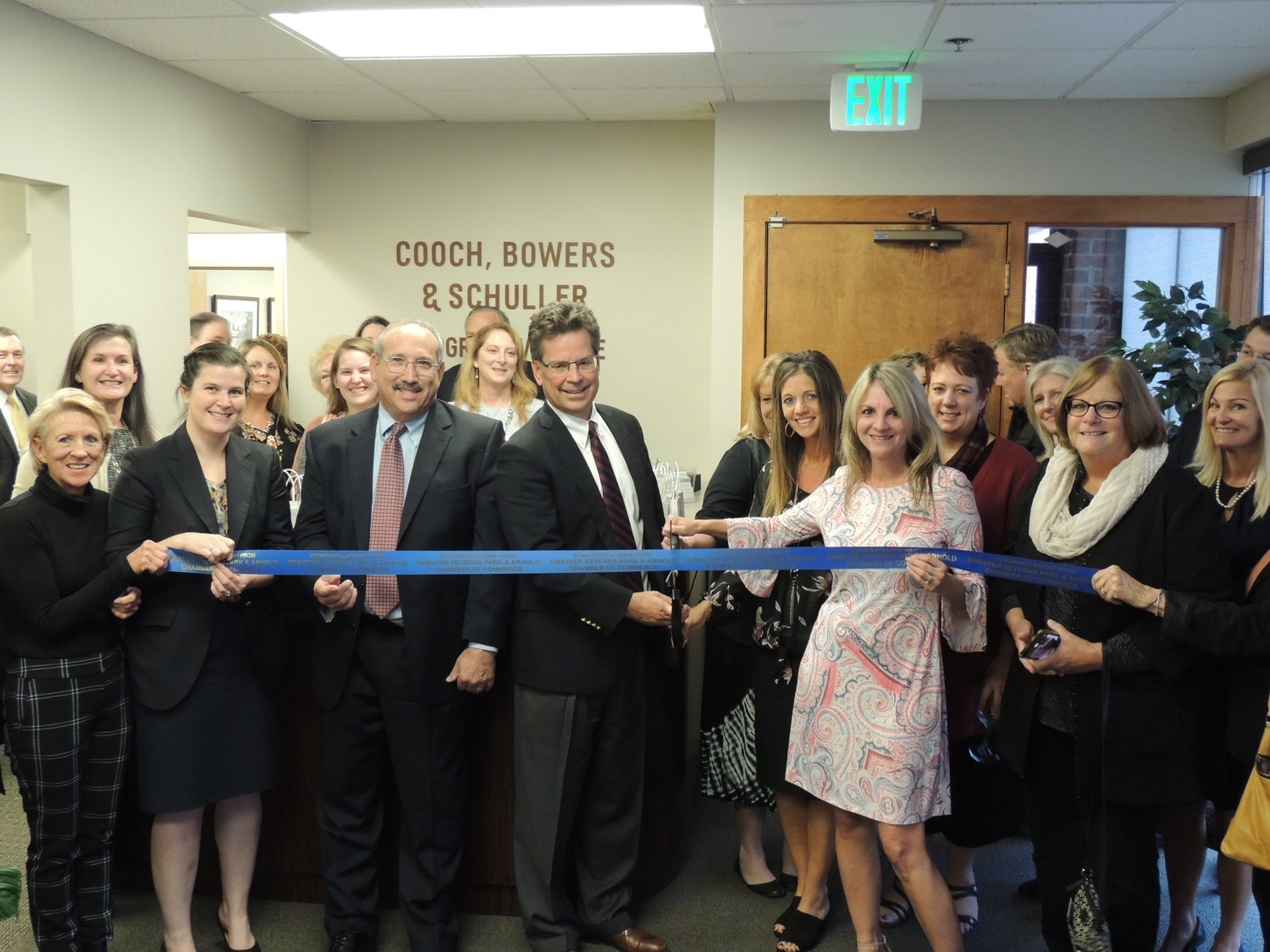 At a recent ceremony through the Greater Severna Park and Arnold Chamber of Commerce, the leadership team behind Cooch, Bowers and Schuller cut the ribbon to celebrate the office's 30th anniversary.