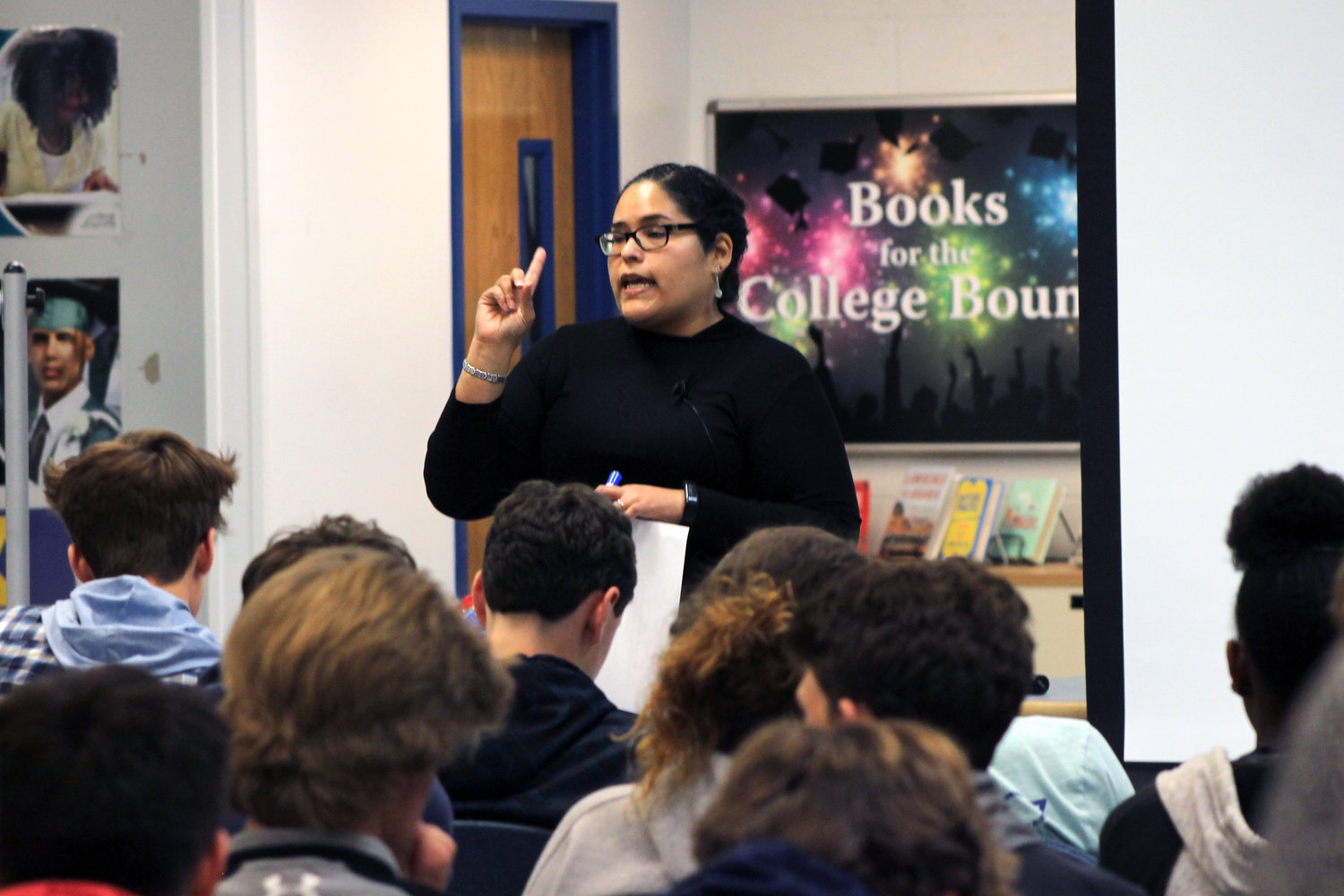 Immigration officer Jules Valencia spoke to students about refugees seeking asylum and the factors that allow them to apply for that status.