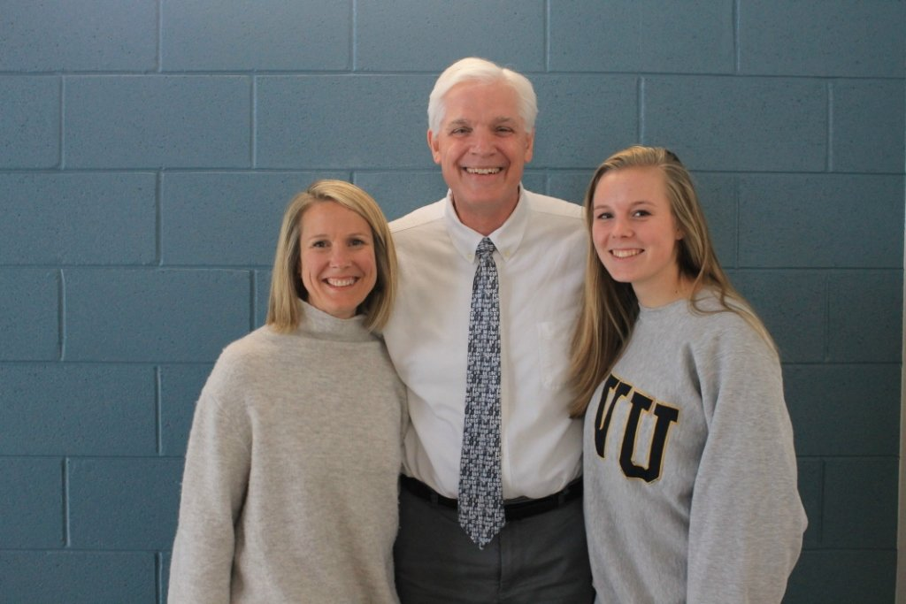 Tim Dunbar (center) stands with two generations he taught at Severna Park High School – mom Kate Marriner and daughter Georgia Marriner.