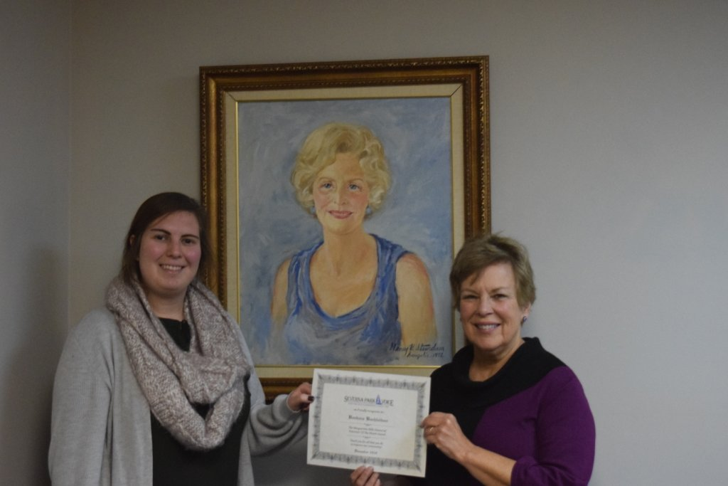 Barbara Buchleitner (right), the December Volunteer of the Month, received her certificate from staff reporter Maya Pottiger.