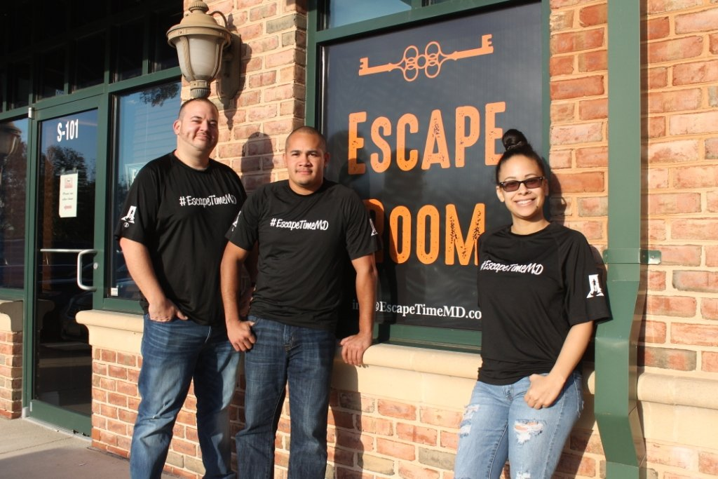 (L-R) Russell Paterno, Jose Matos and Jasmine Torres preside over EscapeTime, which challenges teams to solve various puzzles, riddles and codes within 60 minutes.