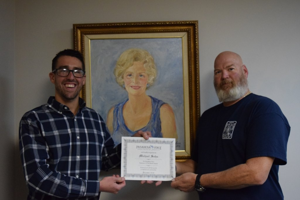 Michael Sohn (right) accepted his Volunteer of the Month certificate from Severna Park Voice editor Dylan Roche.