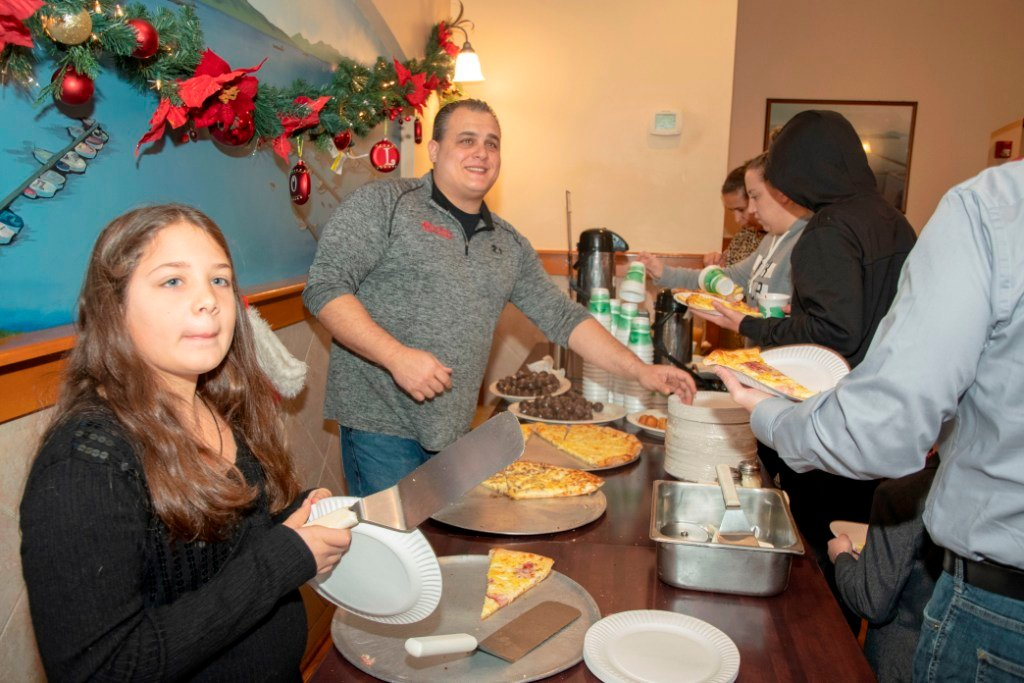 Alessia D'Orazio and Pasquale Carannante served breakfast pizza to guests who walked through the buffet line.