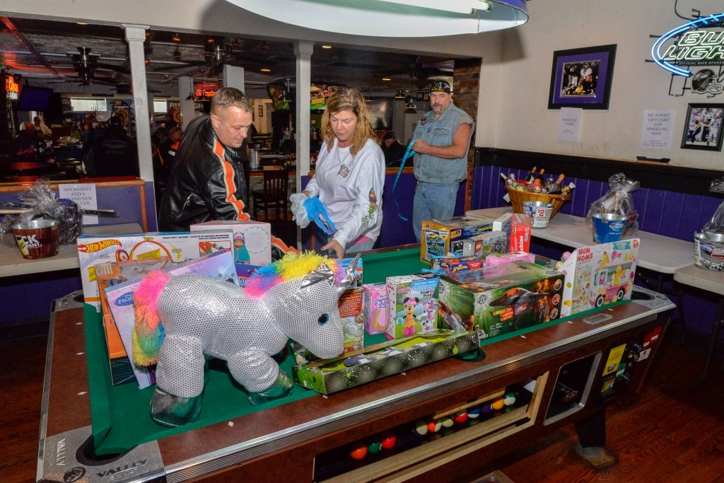Hot Wheels, Legos, dolls, puzzles and remote-controlled vehicles were some of the toys collected during The Office's annual holiday fundraiser.