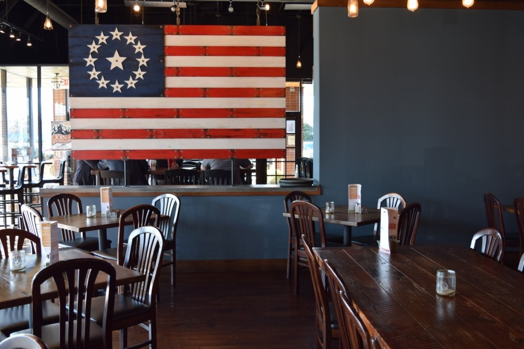 Founders Tavern & Grille may have an old-fashioned interior, but it's all part of the charm — from the American flag to the wooden décor.