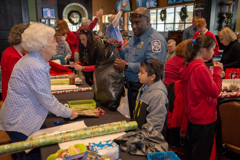 This year, 56 kids shopped with a cop at the Pasadena Walmart. The annual shopping spree is sponsored by the Fort Smallwood Optimist Club.