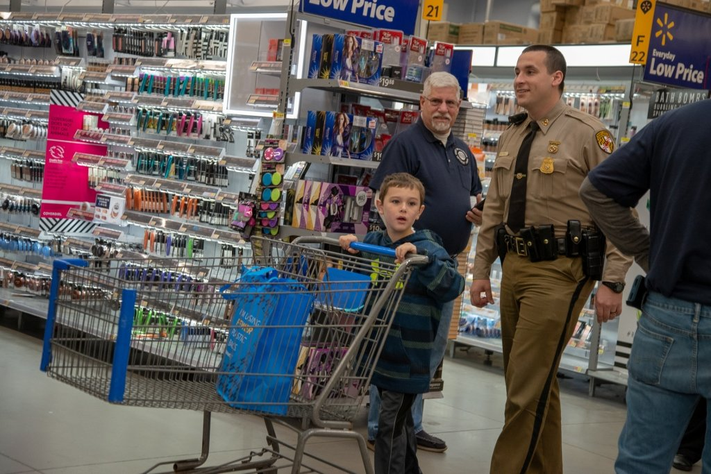 This year, 56 kids shopped with a cop at the Pasadena Walmart. The annual