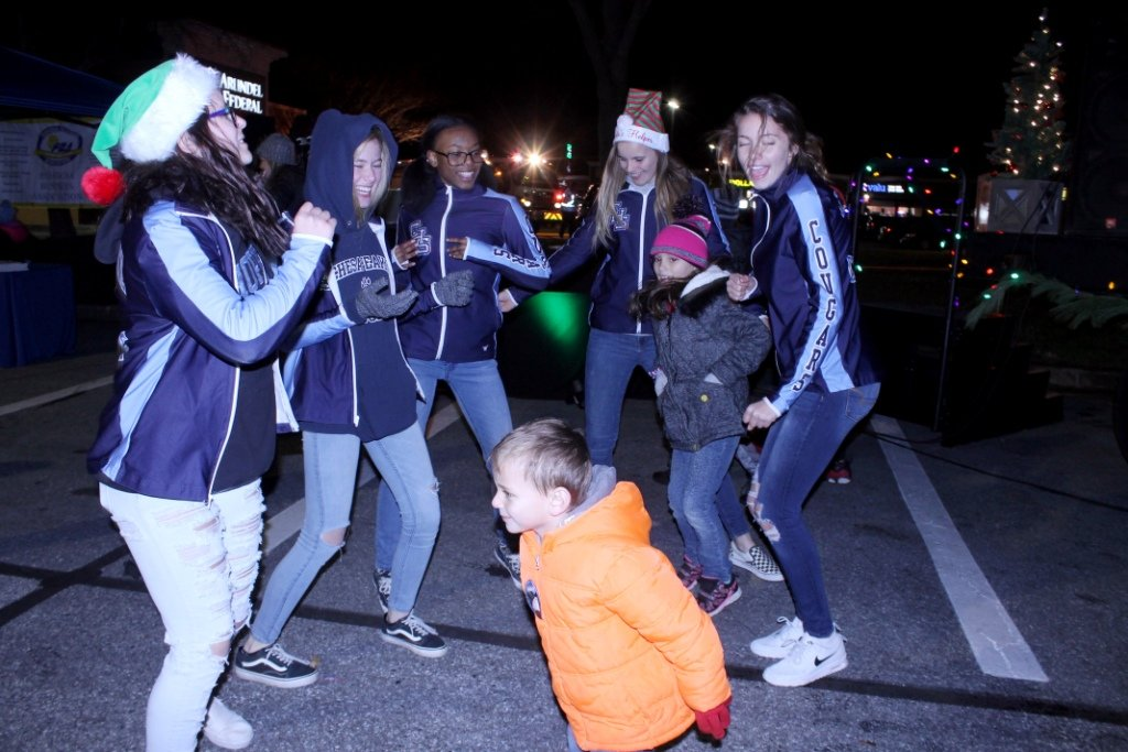 Despite the 35-degree temperature, the PBA Christmas tree lighting drew hundreds of neighbors and friends who played games, met Santa and enjoyed one another's company.