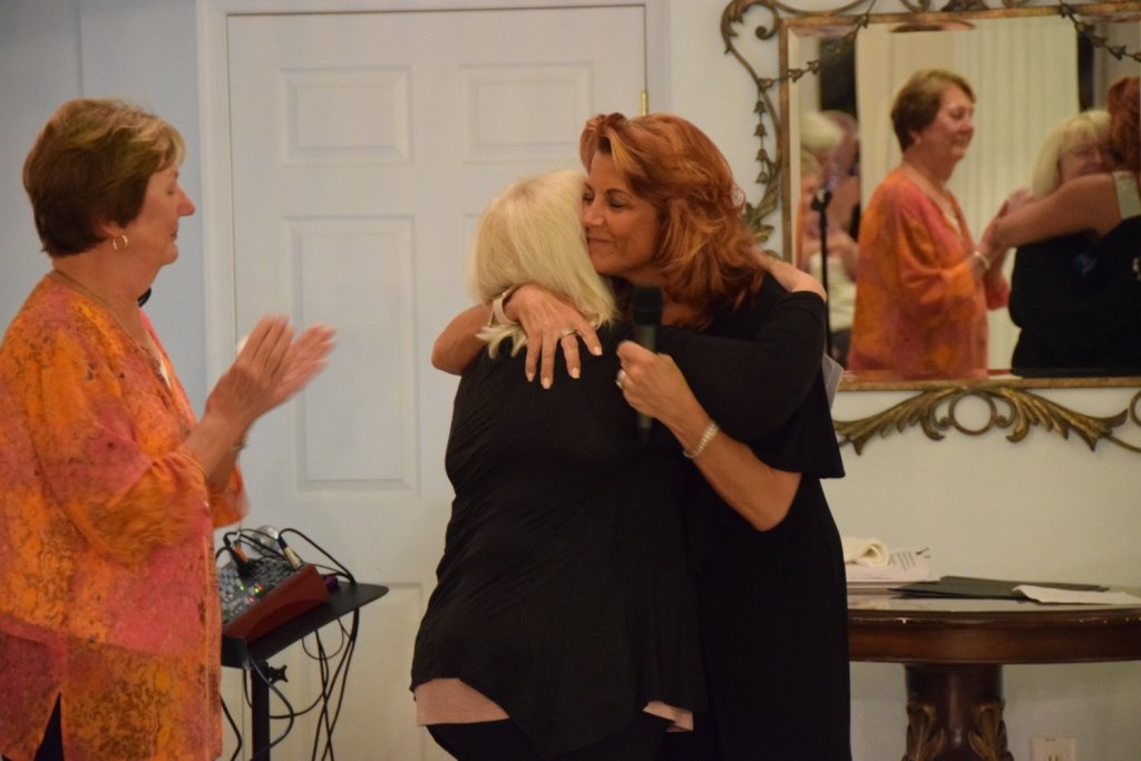 Partners In Care president and CEO Mandy Arnold accepted a hug from Barbara Huston, one of the nonprofit's co-founders.