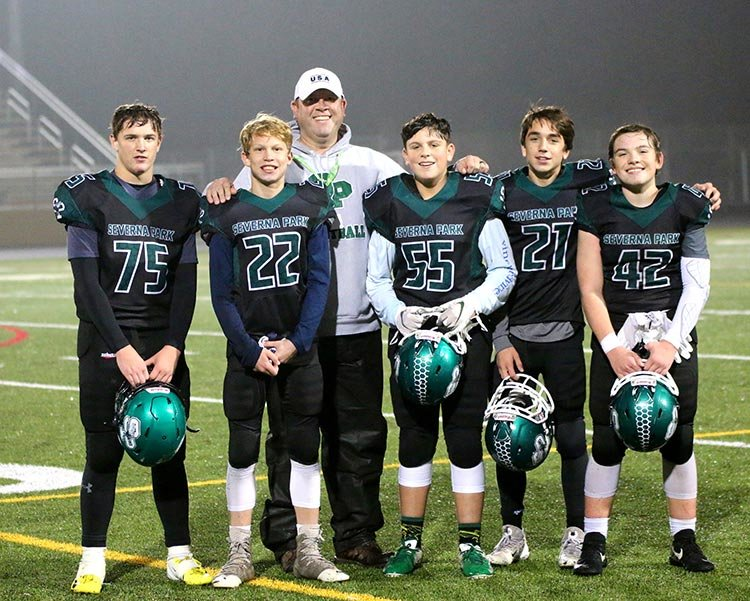 The Green Hornets' Tyler Woodward (75), Kevin Bredeck (22), Daniel Stack (55), Jack Gunther (21) and Ashby Shepherd (42) have been the consistent core of the team since they began playing Green Hornets football seven years ago as 70-pounders.