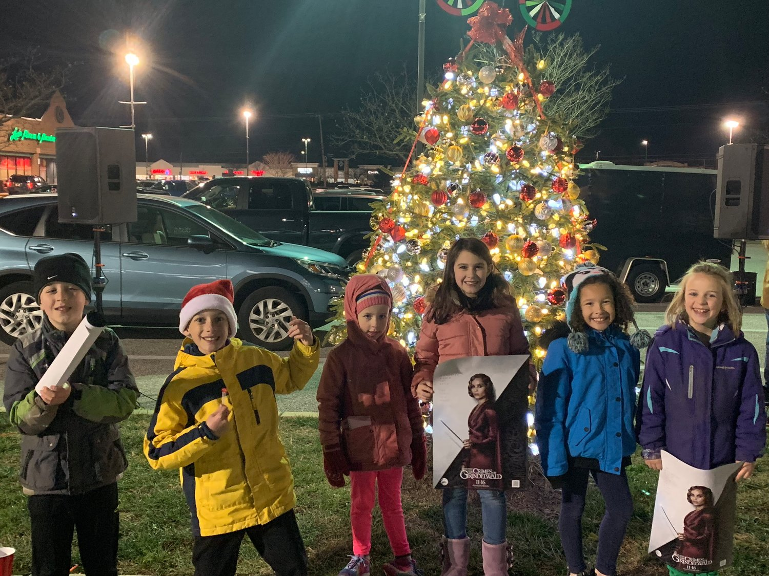 A group of children gathered in front of the Park Plaza Christmas tree after its official first illumination for the season.