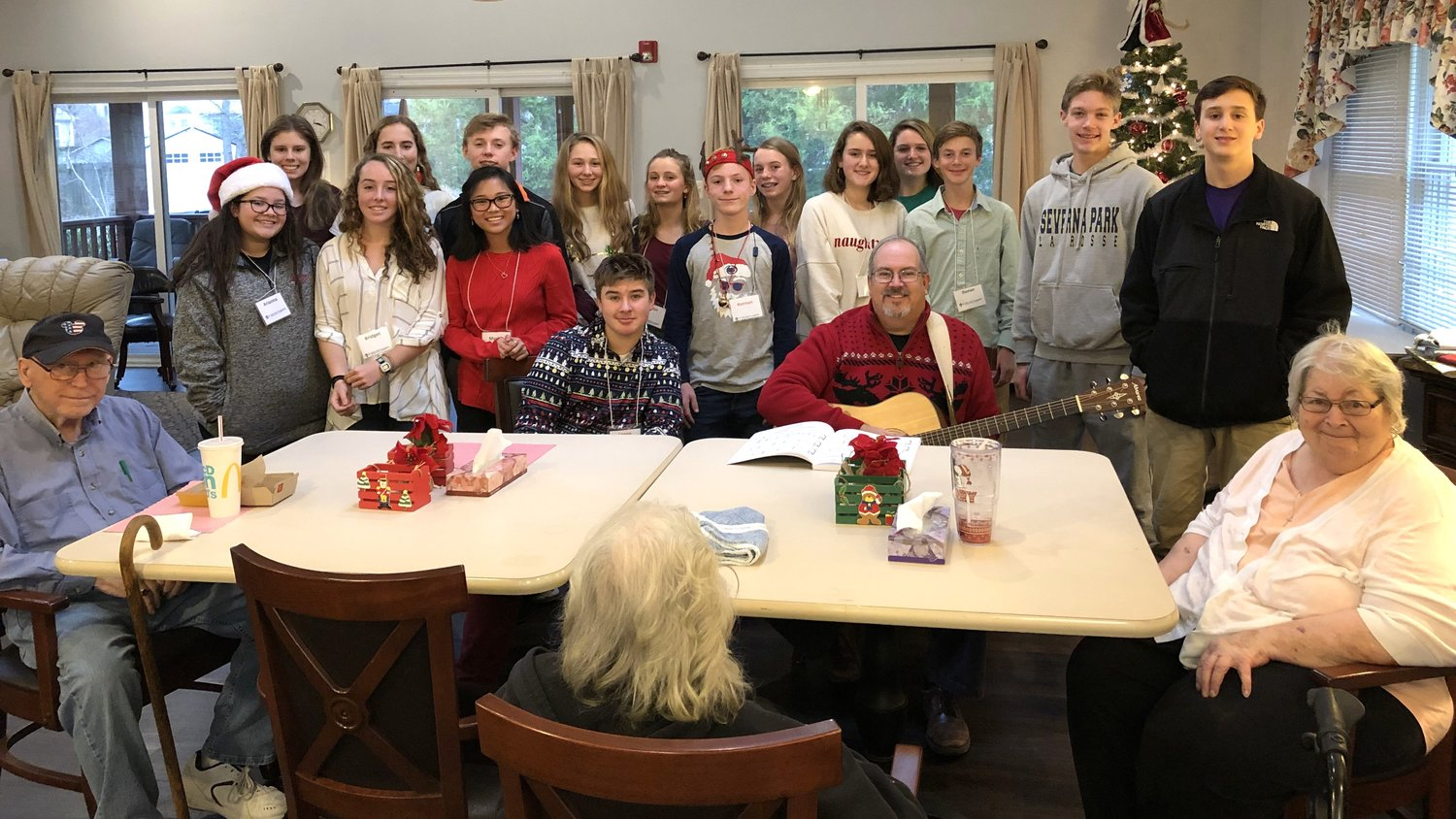 Each of the 13 PearTree residents were paired with a teen who brought gifts, fruit, sweets and a handmade Christmas card for their resident.