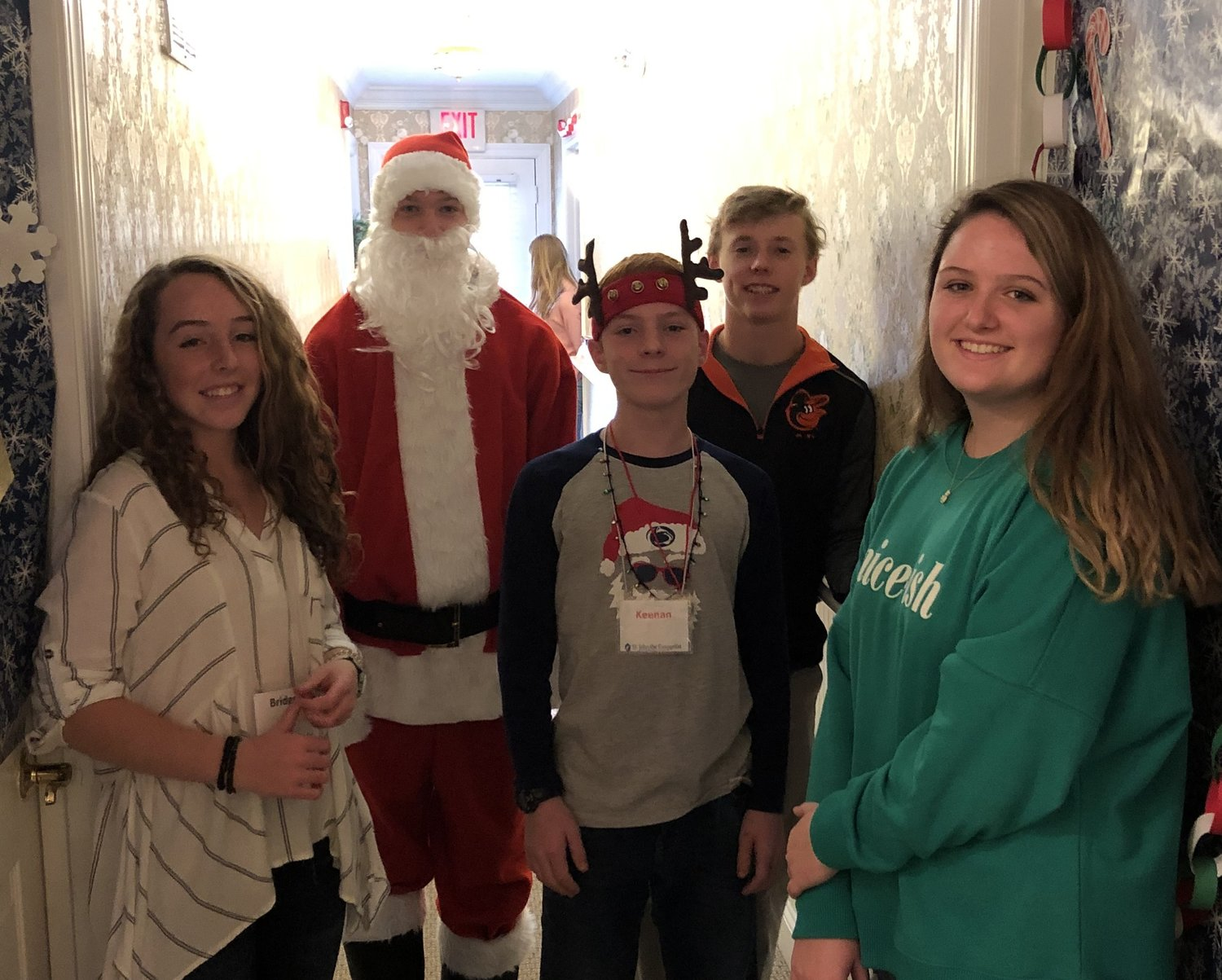 (L-R) Bridget Donovan, Eddie Sullivan, Keenan Kopf, Kyle Garrett and Sydney Bear were part of the St. John group that brought holiday cheer to the residents of PearTree House Assisted Living on December 9.