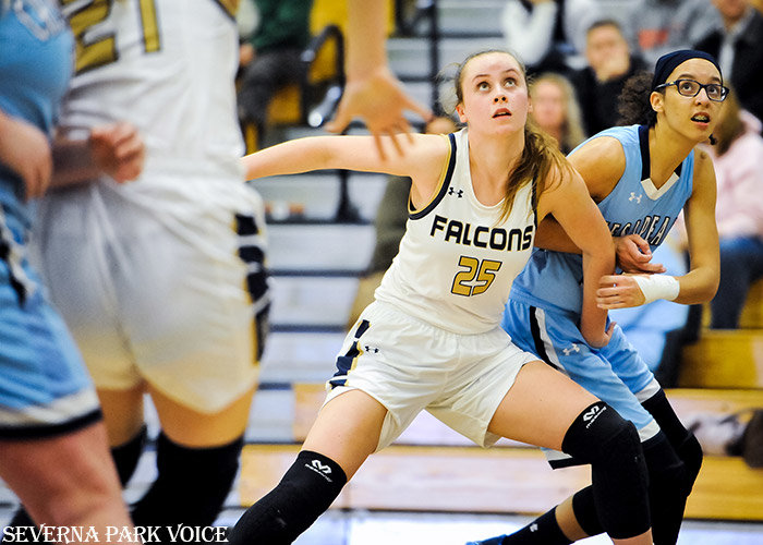 Severna Park's Jess Albert boxed out Chesapeake's Morgan Gray during the Falcons' 34-30 win over the Cougars on January 8. Severna Park held the high-scoring Chesapeake offense to 30 points and only eight field goals, and the Falcons held a 41-28 rebounding advantage.