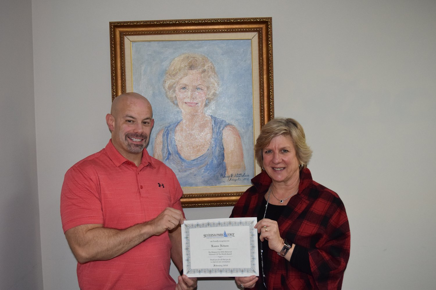 Winter Relief coordinator Laura Nelson received her Volunteer of the Month certificate from Voice vice president of operations Brian Lancione.