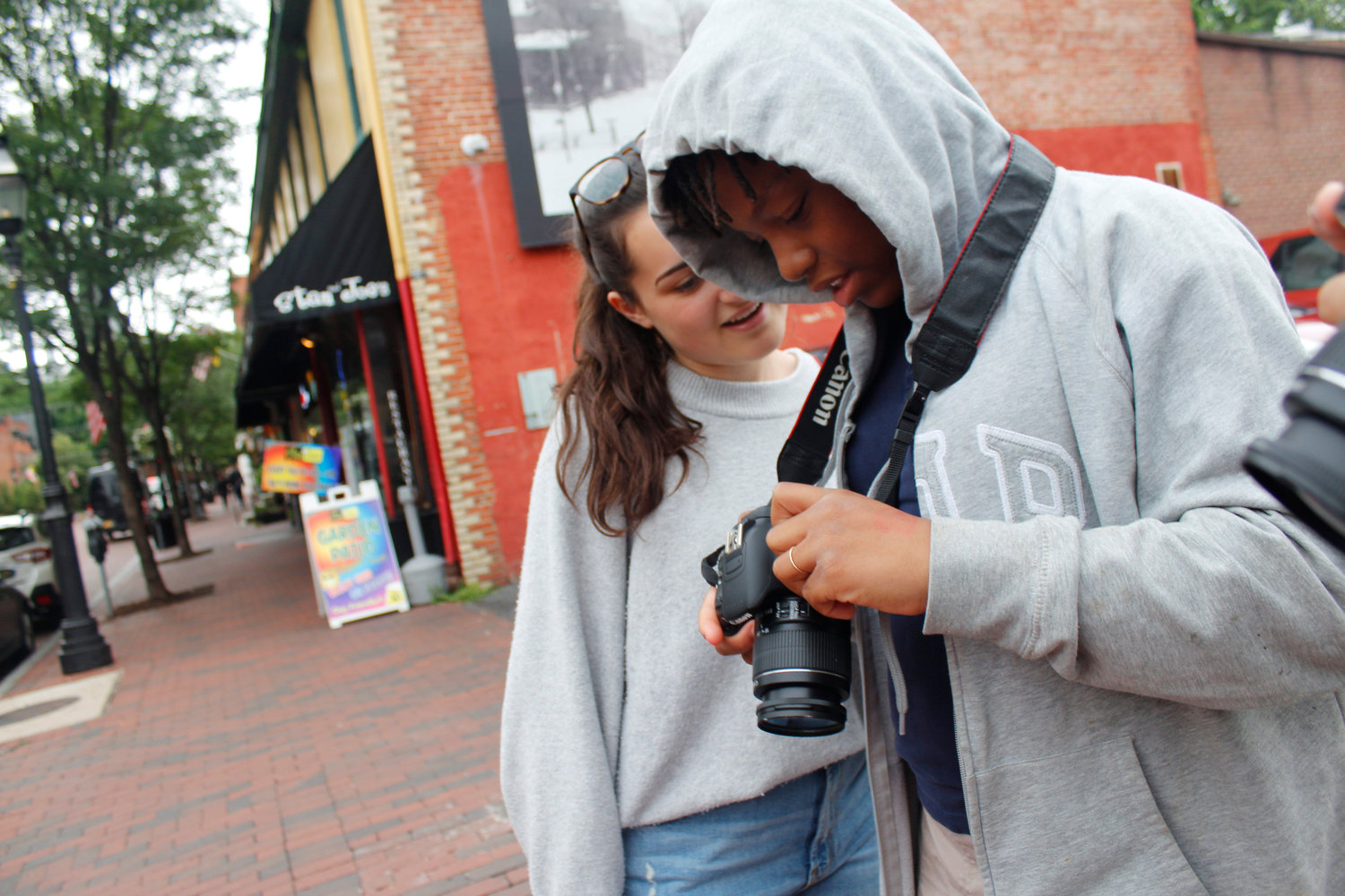 Sophie Macaluso (background) teaches photography during pop-up shops, after-school events and summer camps located in the Annapolis area.