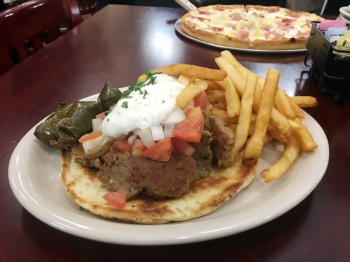 The gyro was the real star of the show. Thick slices of tender, savory meat lay nestled inside a thick, toasty pita, drizzled with a cool cucumber-yogurt sauce.