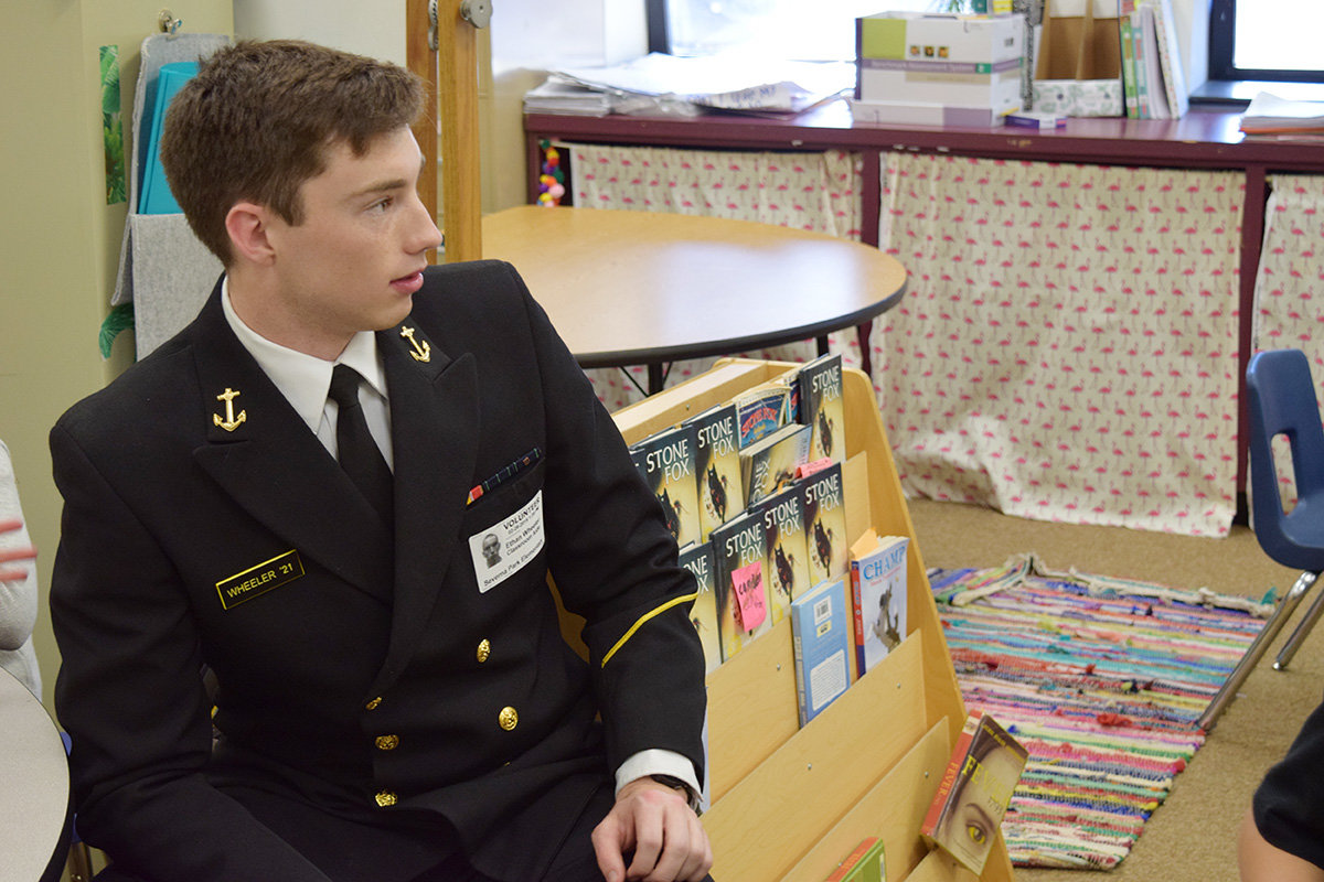 Midshipman Ethan Wheeler sat at a table to connect with a few students.