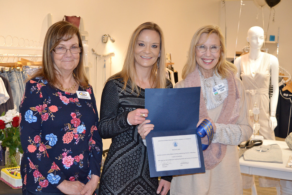 Coterie, a Boutique employees celebrated the shop's five-year anniversary on March 8 with a ribbon cutting ceremony attended by customers and members of the business community.