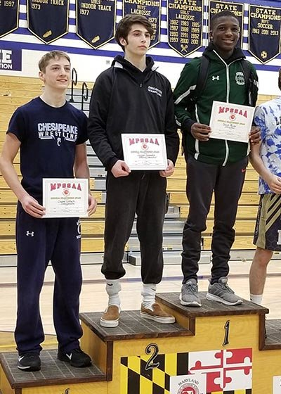 Chase Listorti (left) was the county's runner-up at 113 lbs, placed third in the region and won two bouts at the state meet.