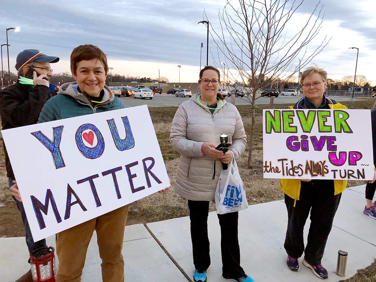 "To send a message to students that they are valued unconditionally, a grassroots group of parents organized an event they dubbed ""One Severna Park"" in early March, when hundreds of parents lined Benfield Road and Robinson Road with signs bearing messages of affirmation."