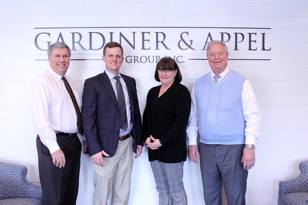 (L-R) Karl Appel, Patrick Cassilly, Debbie Feather and Scott Gardiner, along with Tom Cleaver (not pictured), are the principals at Karl & Appel Group.