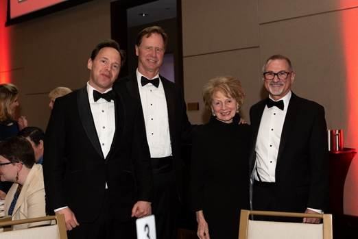 Hospice of the Chesapeake founder Martha O'Herlihy poses with, from left, President of the National Hospice and Palliative Care Organization Edo Banach, Anne Arundel County Executive Steuart Pittman