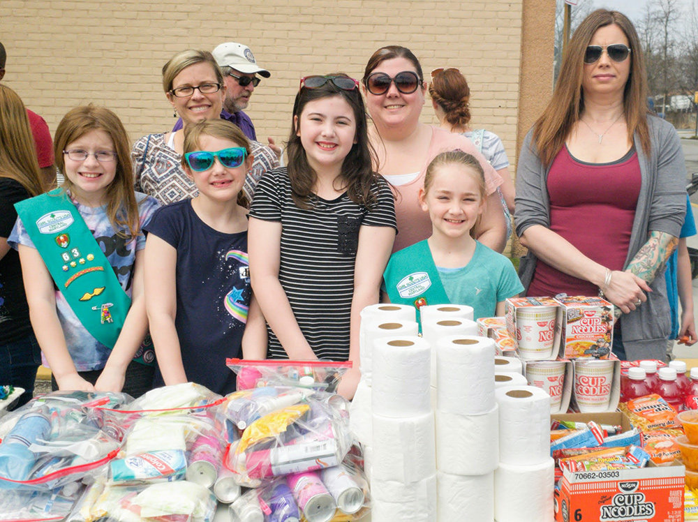 (L-R) Allison Petri, Kadence Falloni, Everly Beavers and Samantha Hesch collected donations of razors, deodorant and sanitary items for the homeless.