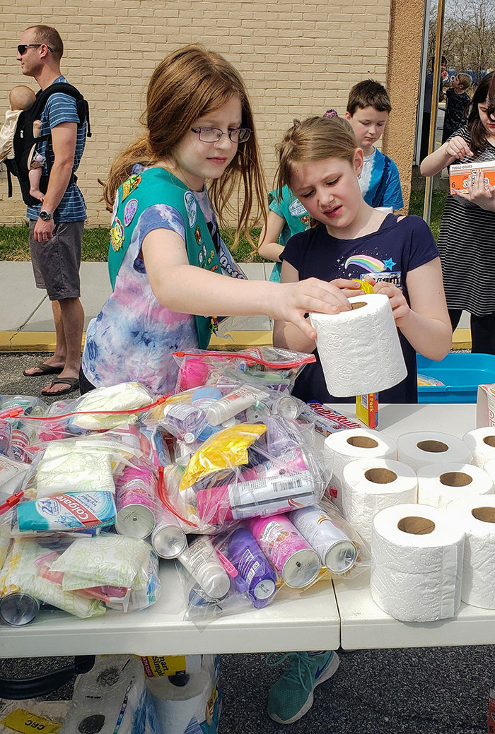 Allison Petri and Kadence Falloni were among the troop members who organized personal toiletry bags for homeless women.