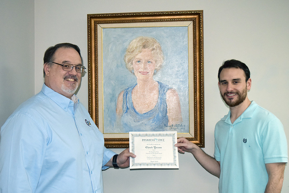 Caring Cupboard LLC President Chuck Yocum received his Volunteer of the Month award from Voice Assistant Editor Zach Sparks.