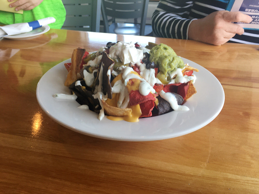 Full of flavor and texture, the nachos were topped with grilled chicken, cheese, jalapeno cream sauce, sliced jalapenos, sliced black olives, guacamole and sour cream.