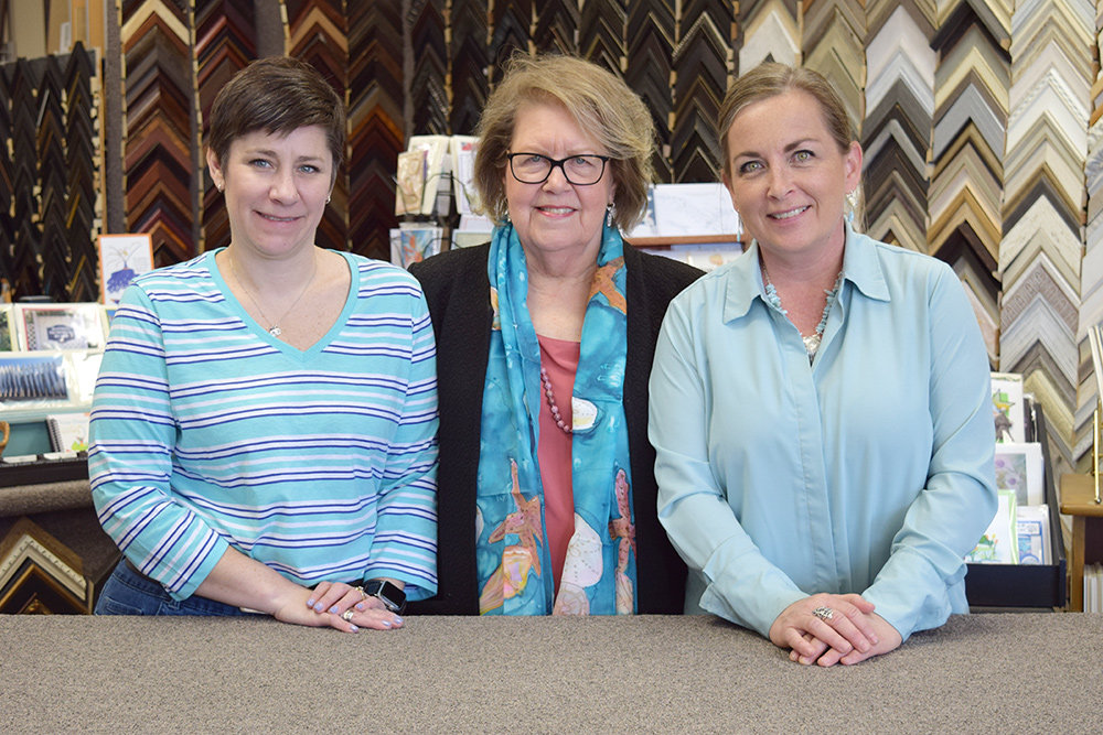(L-R) Stephanie Lavis, Barbara Daniels and Dawn Wilson work at Side Street Framers.