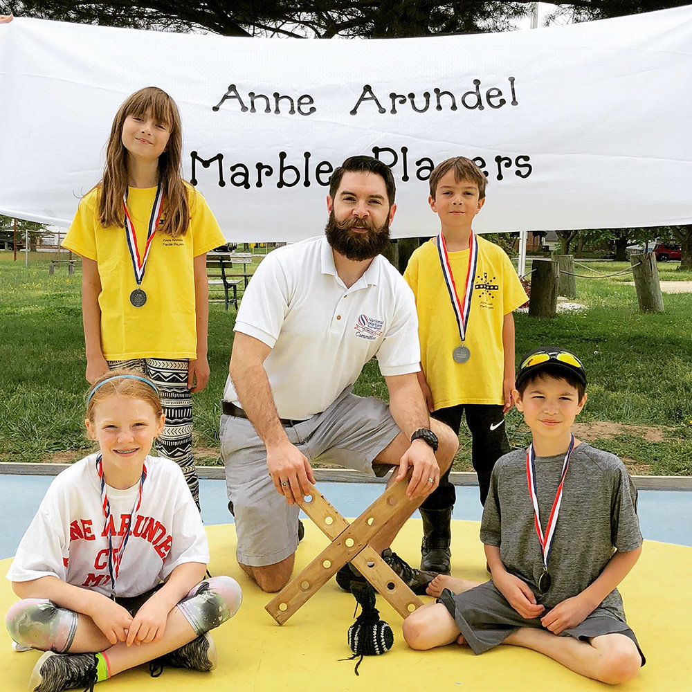 Four Pasadena kids will represent Anne Arundel County in the National Marbles Tournament in June.