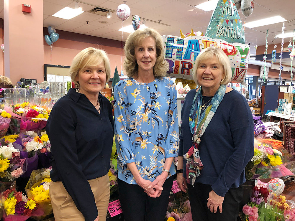 Betty Ann McNelly (middle) said Lauer's Supermarket & Bakery co-owners Bernie Snoops (left) and Babbie Poyer treated her like family during her four decades on the job, first as a cashier and then as a front-end manager.