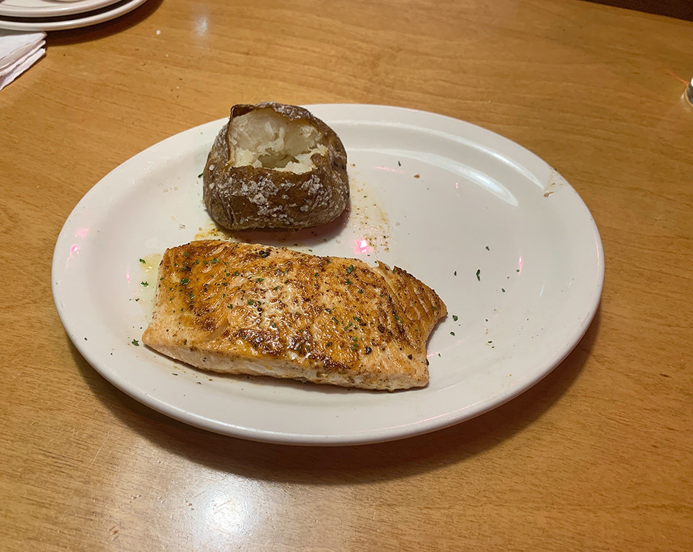 The salmon was hot and tender, grilled to perfection, and topped with lemon-pepper butter.