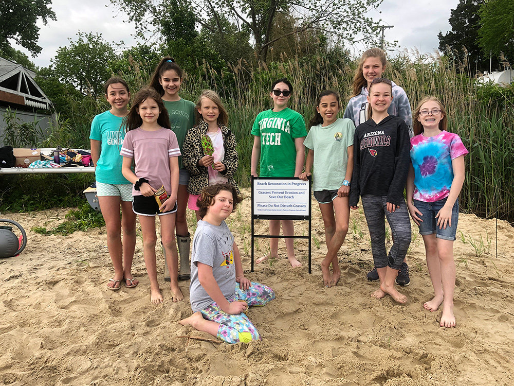 On May 11, Girl Scout Troops 10084 and 2478 worked together to plant bay grasses at Lake Claire Beach to earn their Silver Awards.