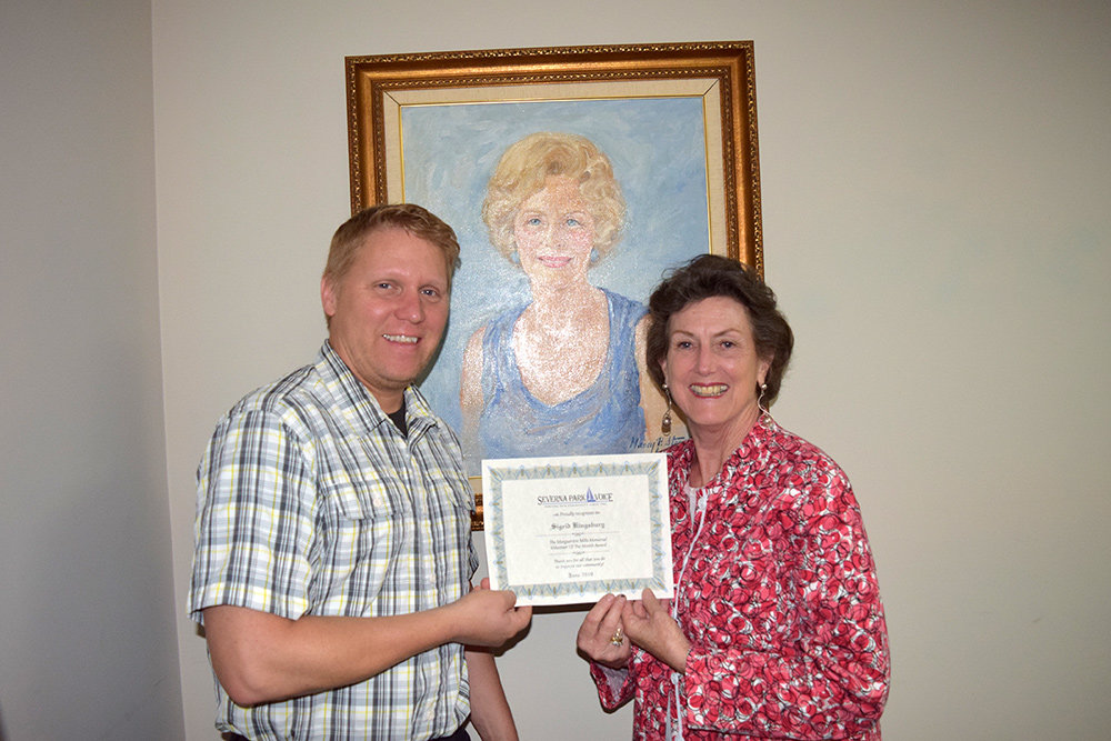 Sigrid Kingsbury received her Volunteer of the Month award from Voice creative director Will Nauman.