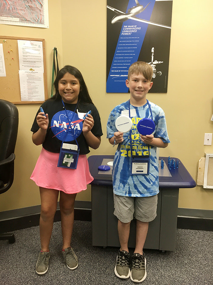 Pasadena Elementary fifth-graders traveled to JA BizTown in May to play the roles of CEO, CFO and photographer.